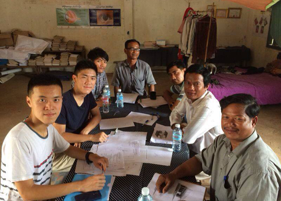 Max (1st left) having meeting with the local partner organisation, Clear Cambodia, which enhances the sustainability of the project by helping to maintain facilities operation and visit the school regularly for hygienic practice.