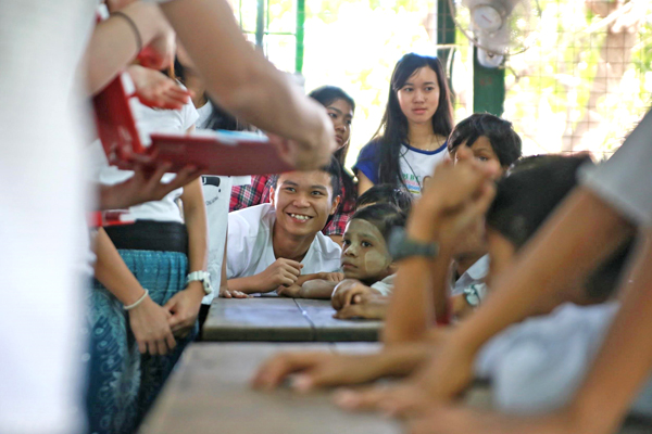Tong Chi-Kit enjoying teaching as a volunteer at a local school in Myanmar.