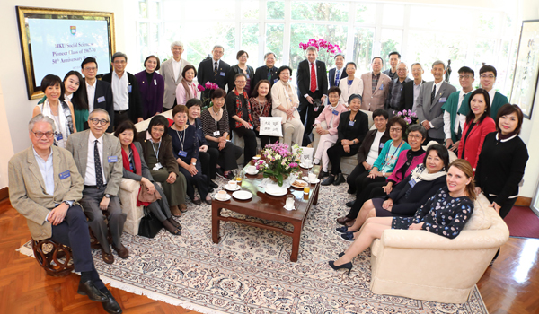 A tea gathering with President Peter Mathieson and Dr Christina Mathieson at the University Lodge